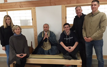 Mark O'Connor and his family in Kyoto meditating with monks