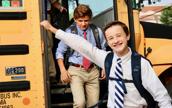 Middle School Student Exiting Bus on First Day